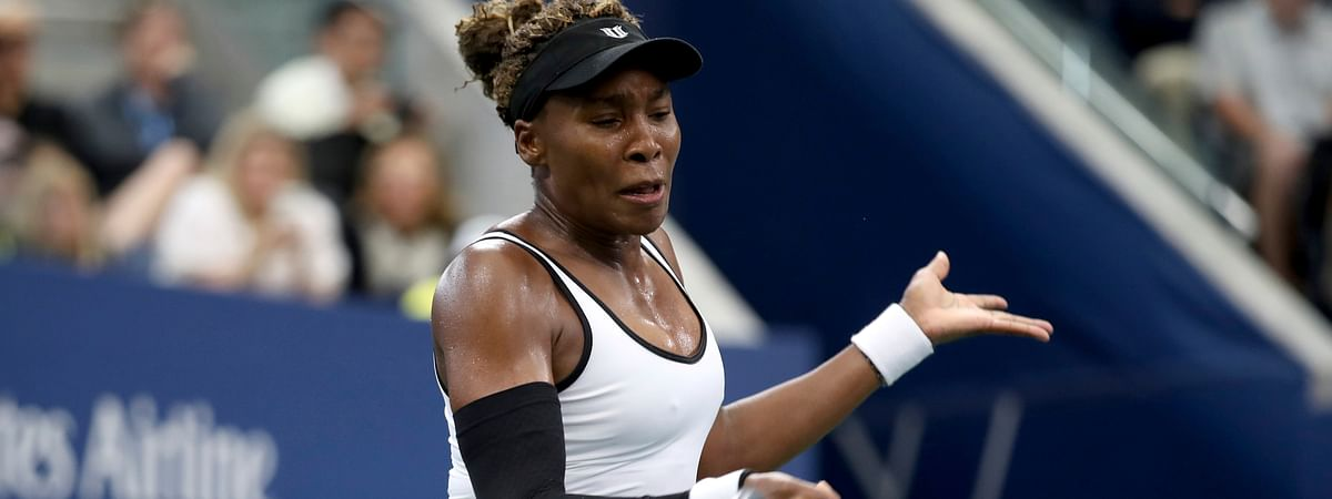 Venus Williams, of the United States, returns a shot to Elina Svitolina, of Ukraine, during the second round of the US Open tennis championships Wednesday, Aug. 28, 2019, in New York.