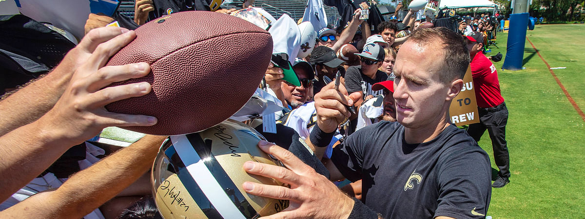 New Orleans Saints quarterback Drew Brees signs autographs for fans following a joint NFL football practice with the Los Angeles Chargers in Costa Mesa, Calif., Thursday, Aug. 15, 2019.