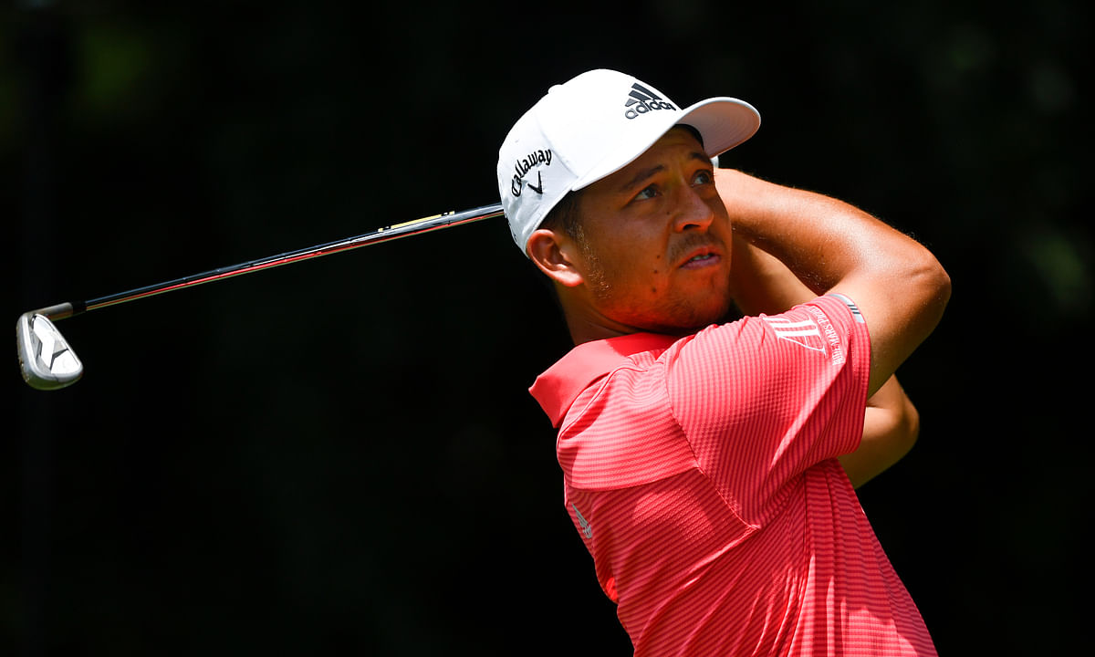 Xander Schauffele tees off on the second hole during the first round of the Tour Championship golf tournament Thursday, Aug. 22, 2019, in Atlanta. (AP Photo/John Amis)