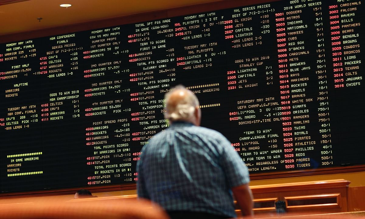 Betting odds are displayed on a board in the sports book at the South Point hotel and casino in Las Vegas. (AP Photo/John Locher)