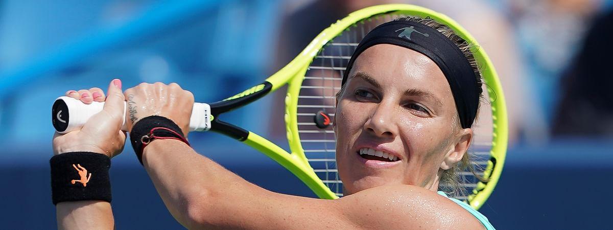 Svetlana Kuznetsova, of Russia, returns to Ashleigh Barty, of Australia, during the Western & Southern Open tennis tournament, Saturday, Aug. 17, 2019, in Mason, Ohio. (AP Photo/John Minchillo)