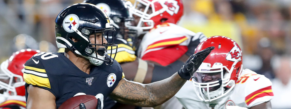 Pittsburgh Steelers running back James Conner (30) runs away from Kansas City Chiefs defensive end Alex Okafor (97) in the first half of a preseason NFL football game, Saturday, Aug. 17, 2019, in Pittsburgh.