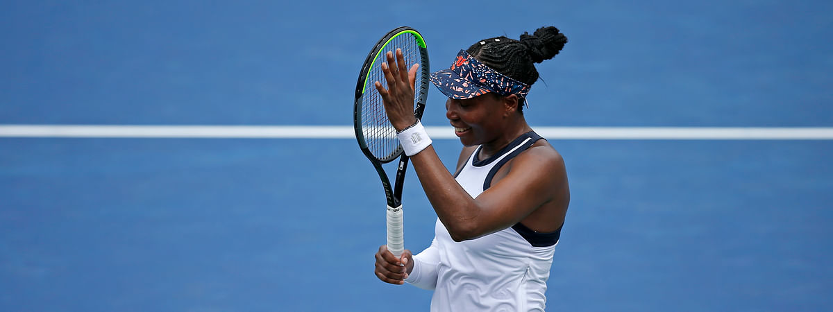 Venus Williams, of the United States, celebrates after her win against Kiki Bertens, of the Netherlands, at the Western & Southern Open tennis tournament in Mason, Ohio, Tuesday, Aug. 13, 2019.