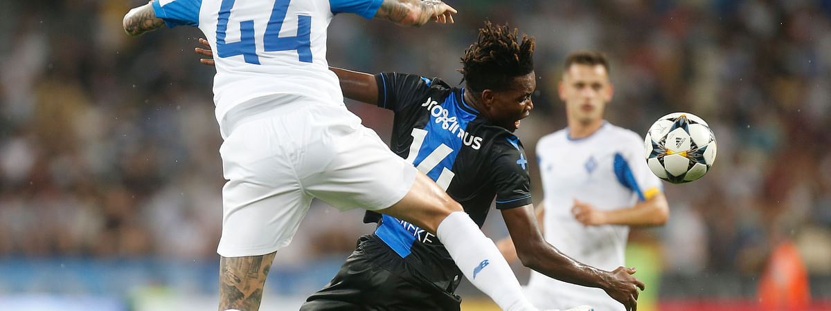 Brugge's David Okereke, right, and Dynamo Kiev's Tamas Kadar challenge for the ball during the Champions League third qualifying round, second leg, soccer match between Dynamo Kyiv and Club Brugge at the Olympiyskiy stadium in Kiev, Ukraine, Tuesday, Aug. 13, 2019.