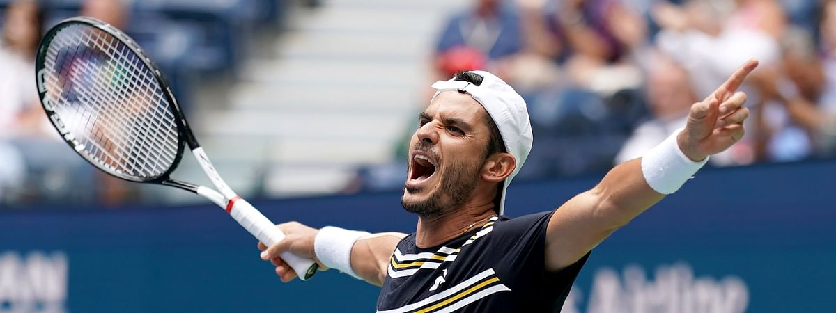 Thomas Fabbiano, of Italy, reacts after defeating Dominic Thiem, of Austria, during the first round of the US Open tennis tournament Tuesday, Aug. 27, 2019, in New York. (AP Photo/Michael Owens)