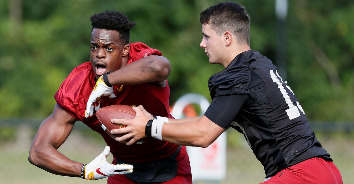 Iowa State quarterback Brock Purdy hands off to running back Kene Nwangwu during practice on Aug. 2 (Charlie Neibergall)