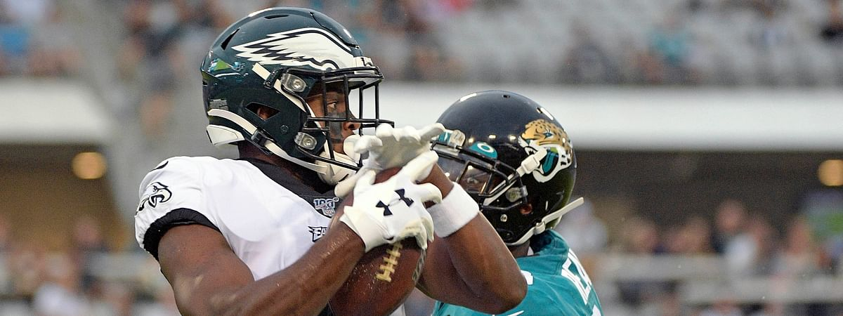 Philadelphia Eagles wide receiver Greg Ward, left, makes a reception in front of Jacksonville Jaguars defensive back C.J. Reavis for a 38-yard touchdown play during the first half of an NFL preseason football game on Aug. 15, 2019 in Jacksonville, Florida.