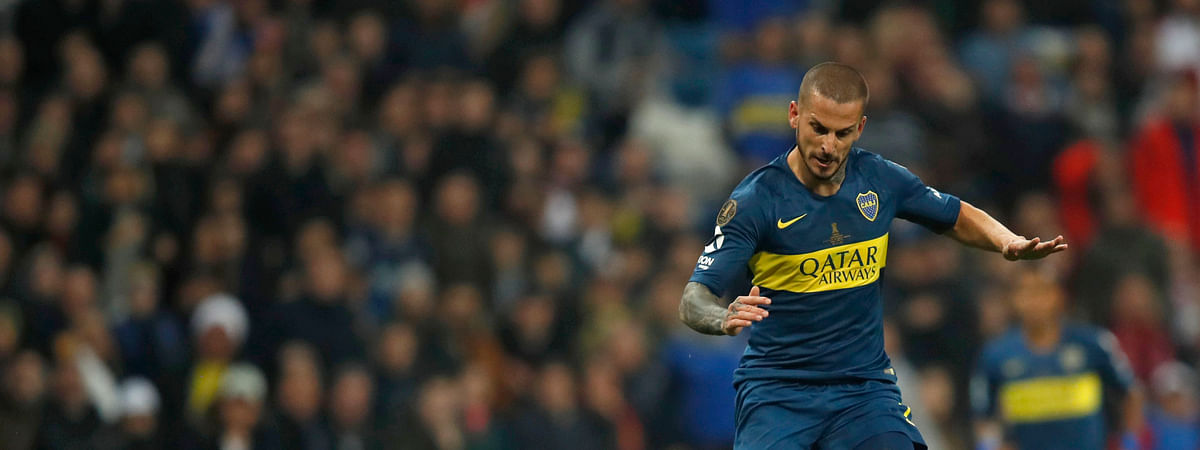 ILE - In this Sunday, Dec. 9, 2018 file photo Dario Benedetto of Argentina's Boca Juniors, right, runs with the ball to score against Argentina's River Plate. Benedetto is now playing for Marseille. (AP Photo/Thanassis Stavrakis, File)