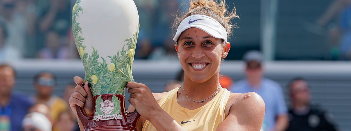 Madison Keys, of the United States, holds the Rookwood Cup after defeating Svetlana Kuznetsova, of Russia, in the women's final match during the Western & Southern Open tennis tournament Sunday, Aug. 18, 2019, in Mason, Ohio. (AP Photo/John Minchillo)