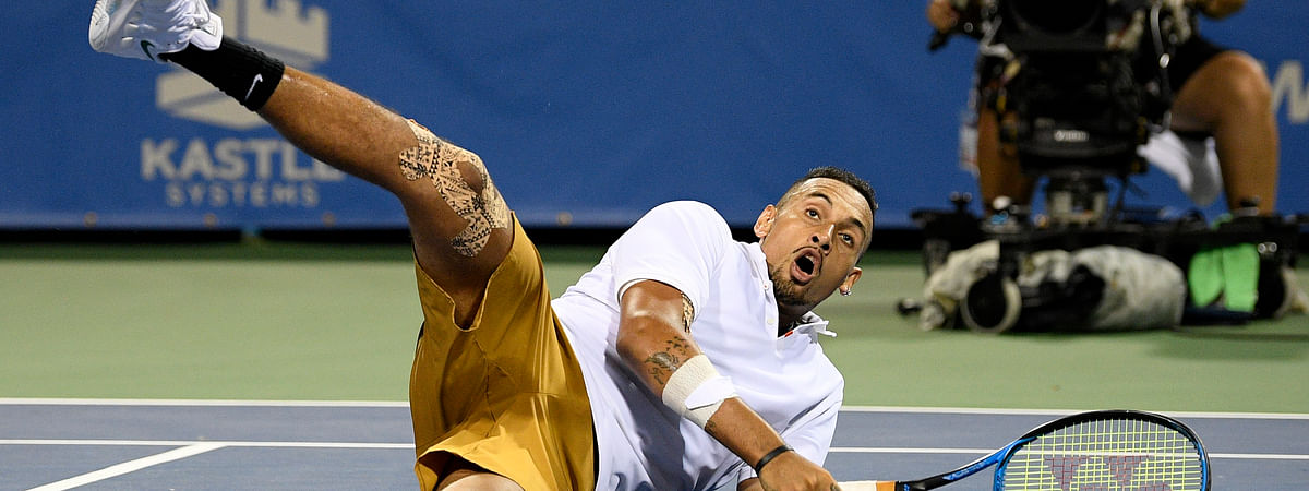 Nick Kyrgios, of Australia, rolls onto the court during a match in the Citi Open tennis tournament against Norbert Gombos, of Slovakia, Friday, Aug. 2, 2019, in Washington. (AP Photo/Nick Wass)