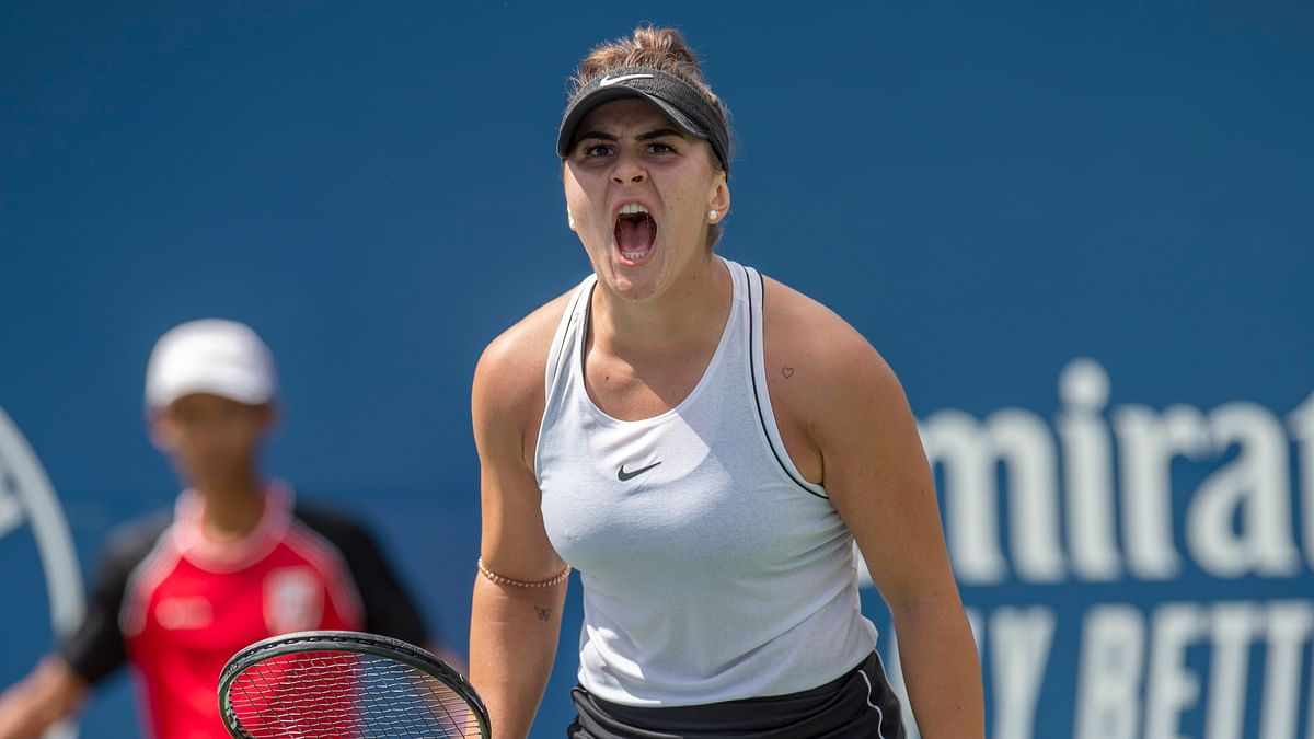 Bianca Andreescu, of Canada, celebrates a point on her way to defeating Sofia Kenin, of the United States during the Rogers Cup women's tennis tournament Saturday, Aug. 10, 2019, in Toronto. (Frank Gunn/The Canadian Press via AP)