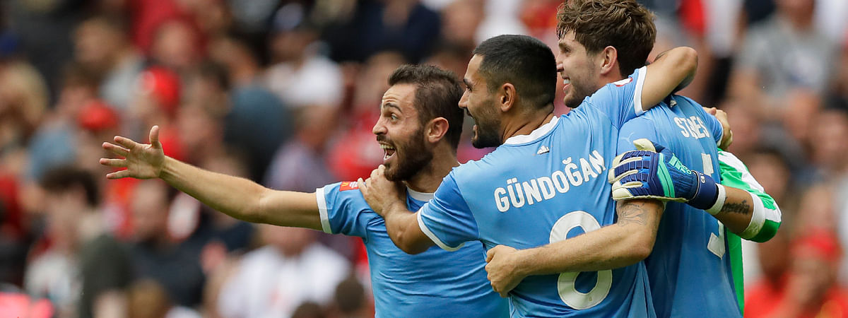 Manchester City's İlkay Gündoğan celebrates with team mates after the penalty shootout during the English Community Shield soccer match between Liverpool and Manchester City at Wembley stadium in London, Sunday, Aug. 4, 2019. (AP Photo/Kirsty Wigglesworth)