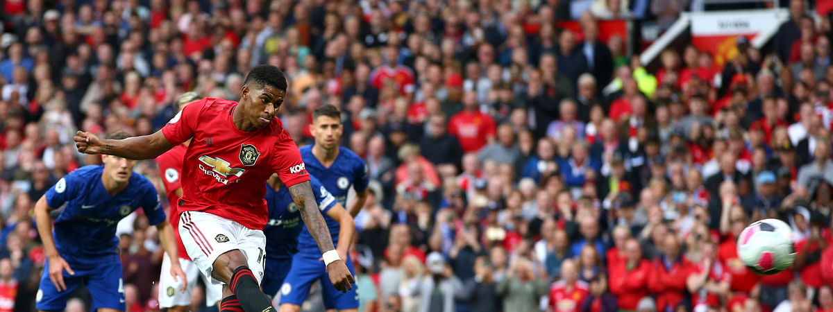 Manchester United's Marcus Rashford shoots a penalty kick to score his sides first goal during the English Premier League soccer match between Manchester United and Chelsea at Old Trafford in Manchester, England, Sunday, Aug. 11, 2019.