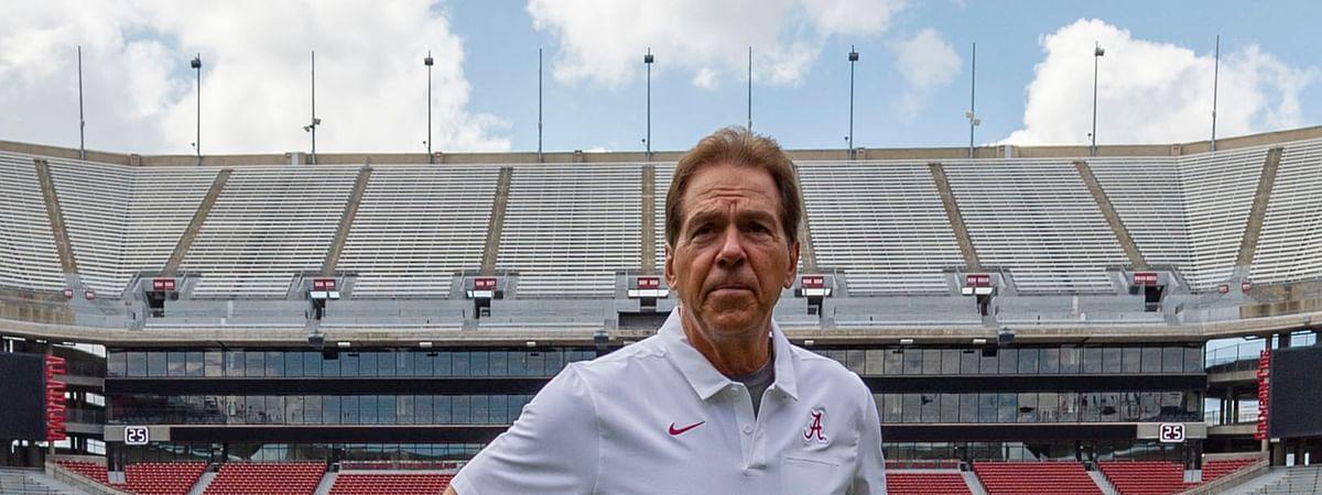 FILE - In this Aug. 3, 2019, file photo, Alabama head coach Nick Saban prepares for a team coach photo prior to Alabama's fall camp fan-day NCAA college football scrimmage at Bryant-Denny Stadium in Tuscaloosa, Ala.  (AP Photo/Vasha Hunt, File)