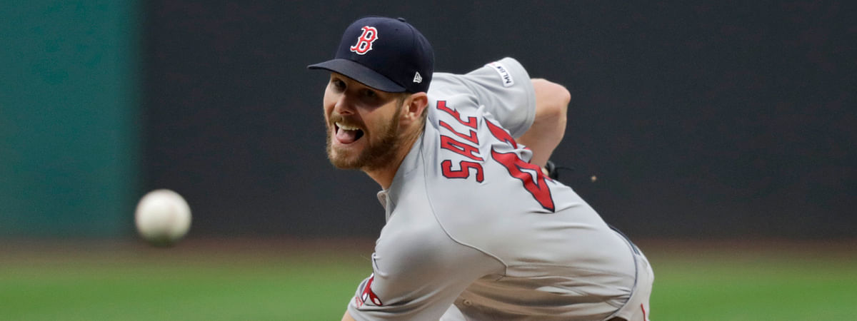 Boston Red Sox starting pitcher Chris Sale delivers in the first inning of the team's baseball game against the Cleveland Indians, Tuesday, Aug. 13, 2019, in Cleveland. (AP Photo/Tony Dejak)