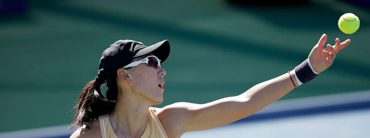 Zheng Saisai, of China, serves the ball to Aryna Sabalenka, of Belarus, during the finals of the Mubadala Silicon Valley Classic tennis tournament in San Jose, Calif., Sunday, Aug. 4, 2019. (AP Photo/Tony Avelar)