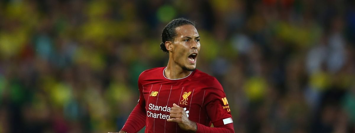 Liverpool's Virgil van Dijk celebrates after scoring his side's third goal during the English Premier League soccer match between Liverpool and Norwich City at Anfield in Liverpool, England, Friday, Aug. 9, 2019. (AP Photo/Dave Thompson)