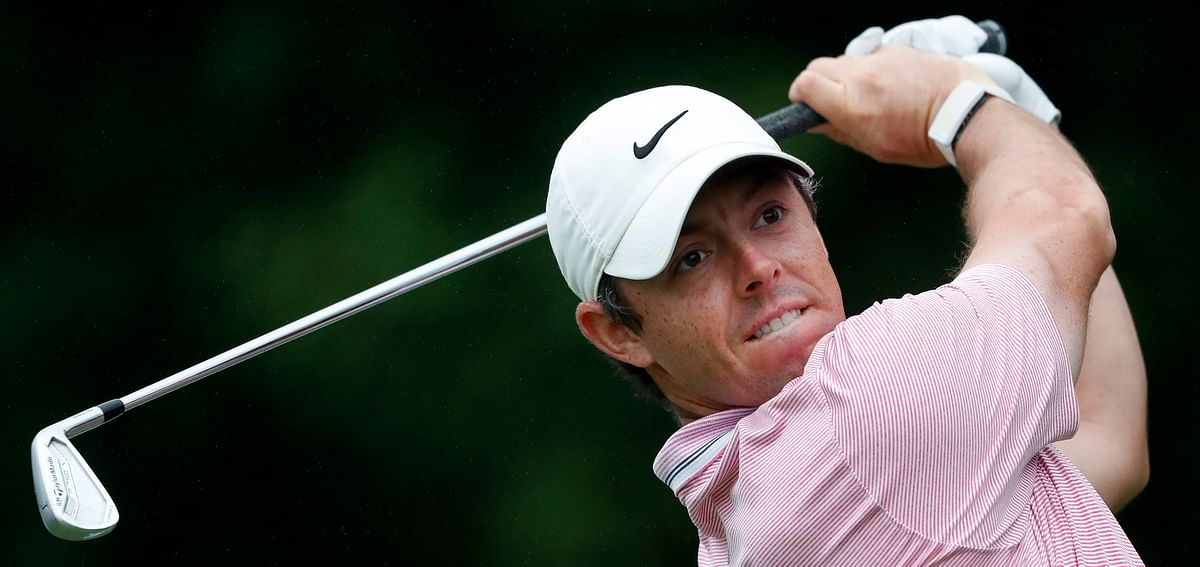 Rory McIlroy follows through on his tee shot from the 11th hole during the third round Aug. 24 (John Bazemore)