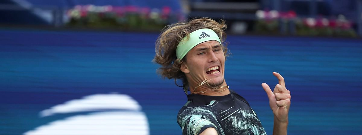 Alexander Zverev, of Germany, returns a shot to Frances Tiafoe, of the United States, during the second round of the US Open tennis championships Thursday, Aug. 29, 2019, in New York. (AP Photo/Kevin Hagen)