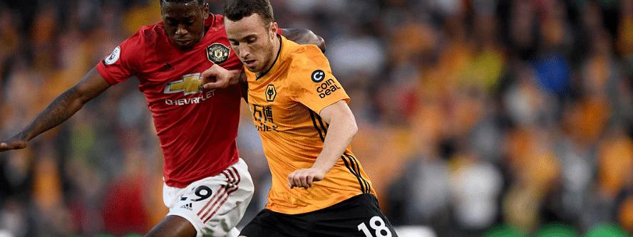 Wolverhampton, in orange, battles Torino in UEFA Europa League action.