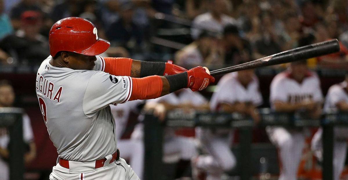 Jean Segura lashes one of the Phillies' 13 hits Aug. 5 in Arizona (Ross D. Franklin)