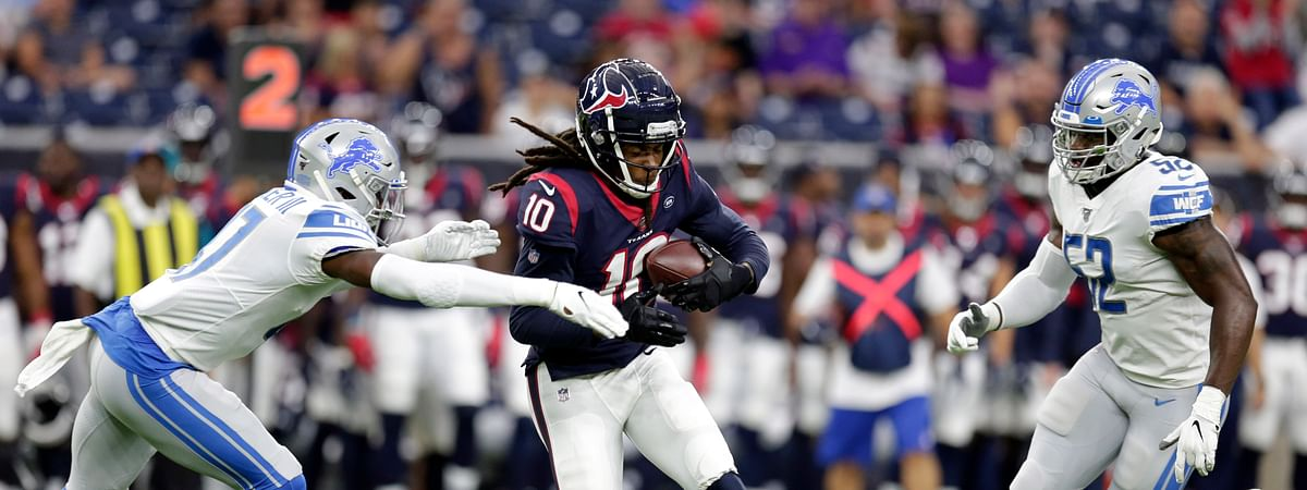 Houston Texans wide receiver DeAndre Hopkins (10) is tackled by Detroit Lions defensive back Tracy Walker (47) as outside linebacker Christian Jones (52) covers during the first half of an NFL preseason football game Saturday, Aug. 17, 2019, in Houston.
