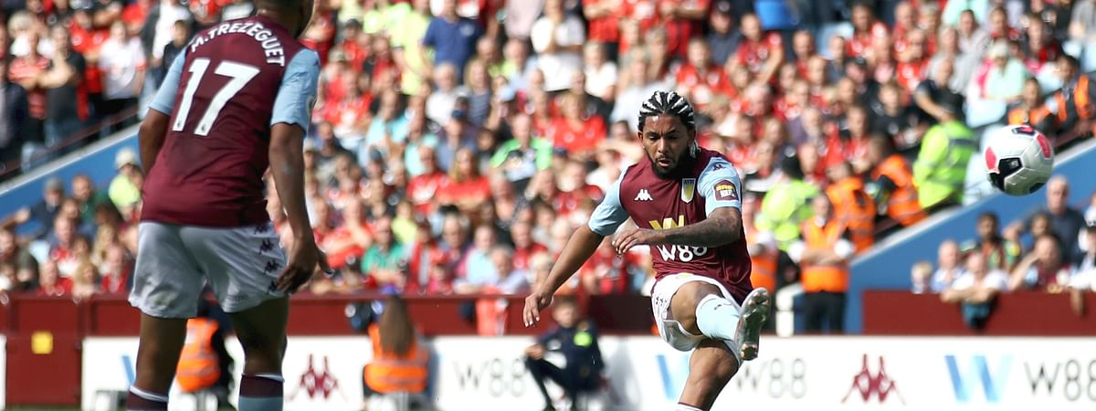 Aston Villa's Douglas Luiz scores his side's first goal of the game, during the English Premier League soccer match between Aston Villa and Bournemouth, at Villa Park, in Birmingham, England, Saturday, Aug. 17, 2019.