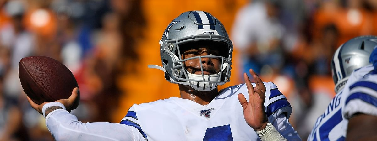 Dallas Cowboys quarterback Dak Prescott throws a pass during the first half of the team's preseason NFL football game against the Los Angeles Rams on Saturday, Aug. 17, 2019, in Honolulu.