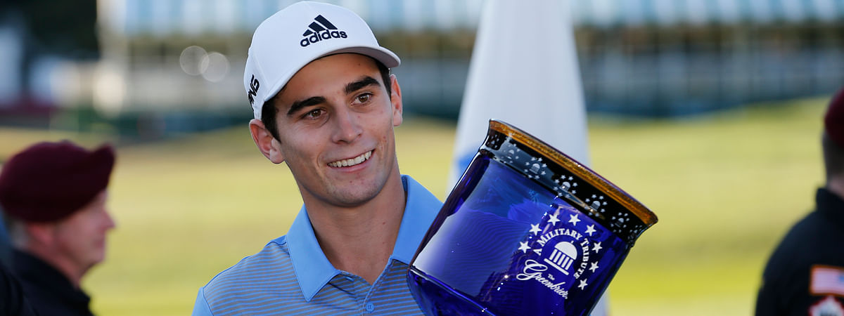 Mike Kern's 33-1 pick Joaquin Niemann, of Chile, holds the winners trophy as he celebrates winning the A Military Tribute at The Greenbrier golf tournament in White Sulphur Springs, W.Va., Sunday, Sept. 15, 2019. Niemann finished the tournament at 21-under-par. (AP Photo/Steve Helber)