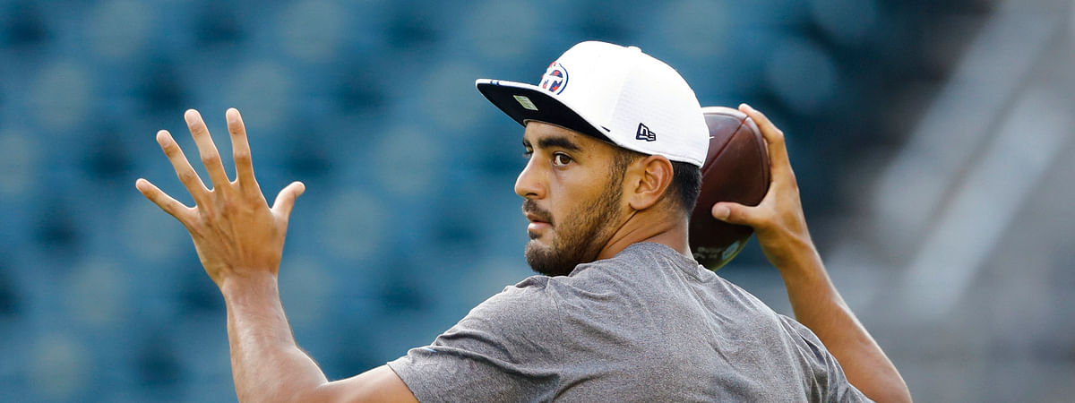 Titans quarterback Marcus Mariota (shown in pregame warm-ups on Aug. 8) has his eyes on the Browns in Week 1 (Matt Rourke)