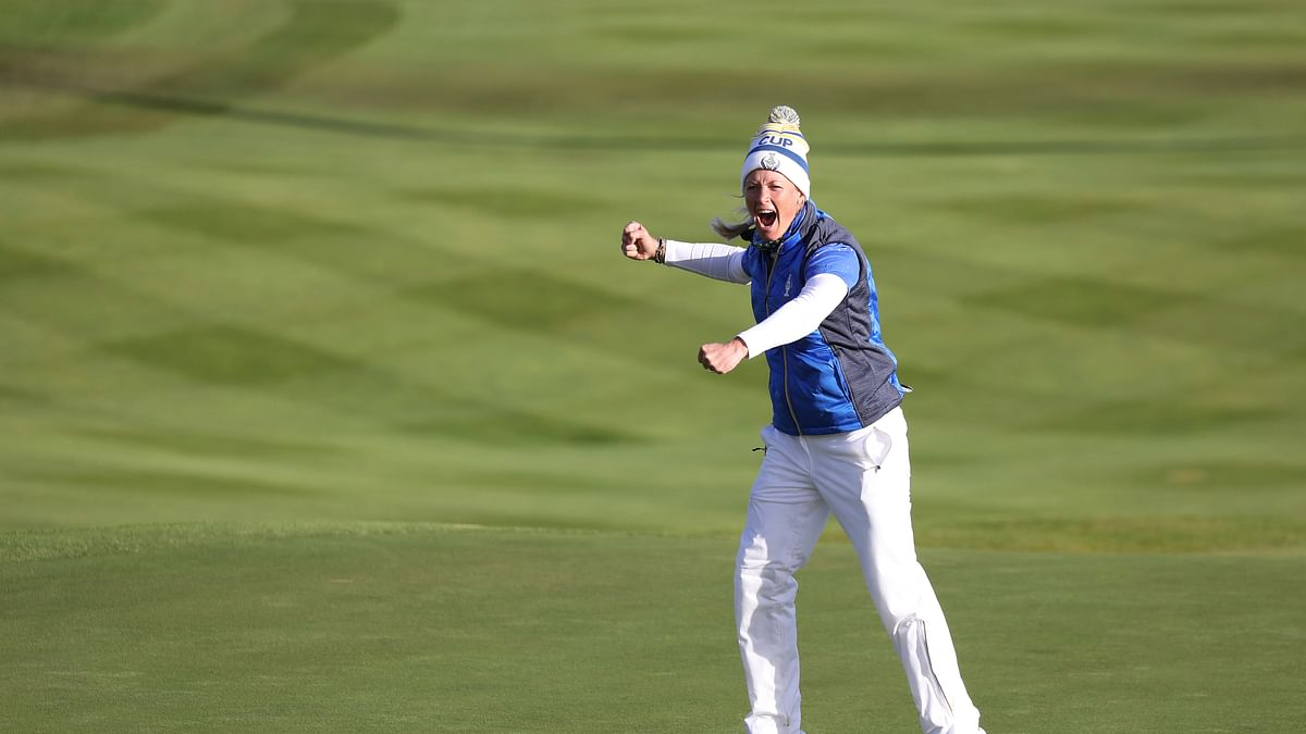 Golf: Europe regains Solheim Cup, comes back to beat U.S. 14 1/2-13 1/2 as Suzann Pettersen knocks in putt on final hole