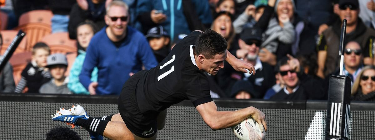New Zealand's George Bridge is airborne as he dives across the line to score a try against Tonga during their rugby test match in Hamilton, New Zealand, Saturday, Sept. 7, 2019. The All Blacks defeated Tonga 92-7. (Andrew Cornaga/Photosport via AP)