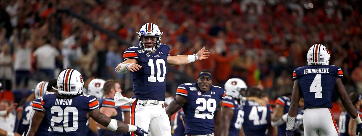 Auburn quarterback Bo Nix (10) celebrates with teammates after Auburn came from behind to defeat Oregon following an NCAA college football game, Saturday, Aug. 31, 2019, in Arlington, Texas. Auburn won 27-21. (AP Photo/Ron Jenkins)