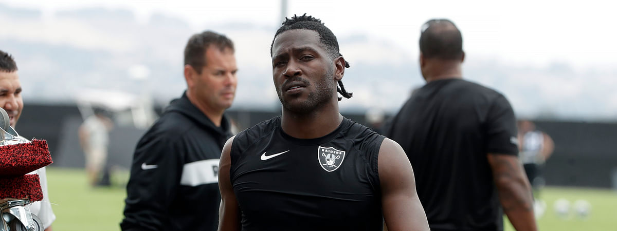 New England Patriots wide receiver Antonio Brown, seen here while with the Oakland Raiders, is facing sexual assault allegations leveled by a former trainer. (AP Photo/Jeff Chiu, File)