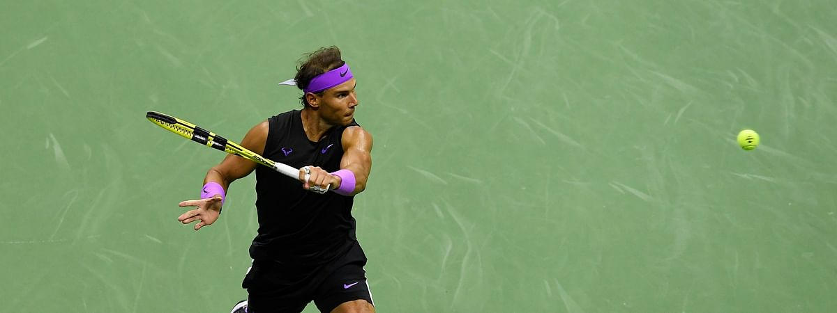 Rafael Nadal, of Spain, returns a shot to Matteo Berrettini, of Italy, during the men's singles semifinals of the U.S. Open tennis championships Friday, Sept. 6, 2019, in New York. (AP Photo/Sarah Stier)