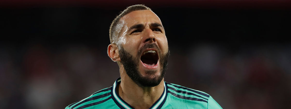 Real Madrid's Karim Benzema celebrates after scoring his side's opening goal during the Spanish La Liga soccer match between Sevilla and Real Madrid at the Ramon Sanchez Pizjuan stadium in Seville, Spain, Sunday, Sept. 22, 2019. (AP Photo/Miguel Morenatti)