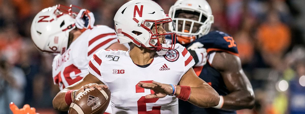 Nebraska quarterback Adrian Martinez (2) passes in the first half of an NCAA college football game against Illinois, Saturday, Sept. 21, 2019, in Champaign, Ill.