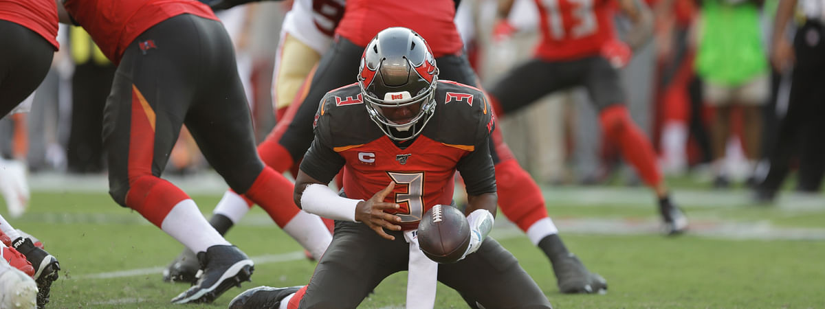 Tampa Bay Buccaneers quarterback Jameis Winston (3) tries to keep a loose ball against the San Francisco 49ers during the second half an NFL football game, Sunday, Sept. 8, 2019, in Tampa, Fla.