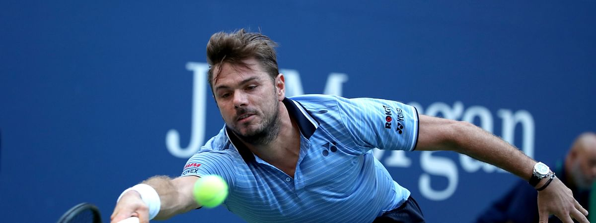 Stan Wawrinka, of Switzerland, returns a shot to Paolo Lorenzi, of Italy, during round three of the US Open tennis championships Friday, Aug. 30, 2019, in New York. (AP Photo/Michael Owens)