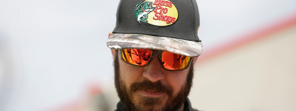 Martin Truex Jr. pauses to sign an autograph for a fan during practice for Sunday's NASCAR Cup Series auto race at Charlotte Motor Speedway in Concord, N.C., Saturday, Sept. 28, 2019. (AP Photo/Gerry Broome)
