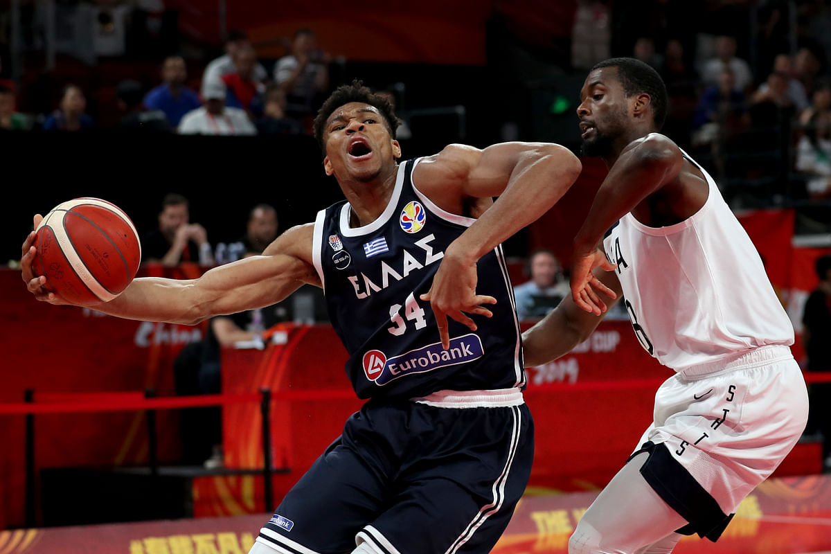 Greece's Giannis Antetokounmpo tries to get past United States' Harrison Barnes during phase two of the FIBA Basketball World Cup at the Shenzhen Bay Sports Center in Shenzhen in southern China's Guangdong province on Saturday, Sept. 7, 2019.United States beat Greece 69-53. (AP Photo/Ng Han Guan)