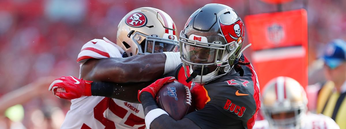 San Francisco 49ers linebacker Dre Greenlaw (57) hits Tampa Bay Buccaneers running back Ronald Jones II (27) during the first half an NFL football game, Sunday, Sept. 8, 2019, in Tampa, Fla. (AP Photo/Mark LoMoglio)