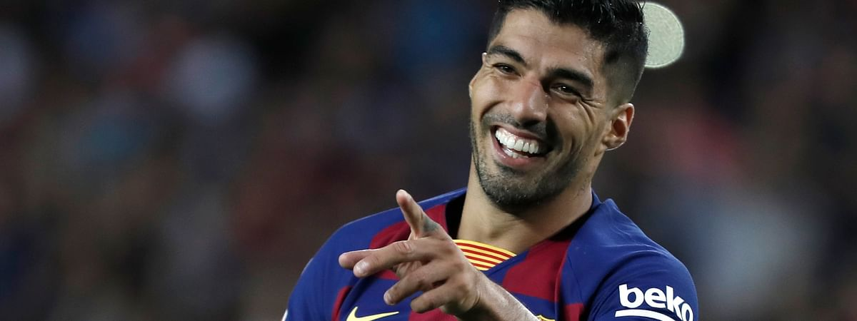 Barcelona's Luis Suarez celebrates after scoring his side's fifth goal during the Spanish La Liga soccer match between FC Barcelona and Valencia CF at the Camp Nou stadium in Barcelona, Spain, Saturday, Sep. 14, 2019.