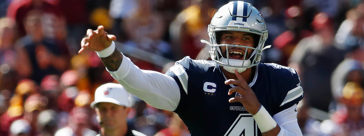 Dallas Cowboys quarterback Dak Prescott (4) passes downfield during the second half of an NFL football game, Sunday, Sept. 15, 2019, in Landover, Md.