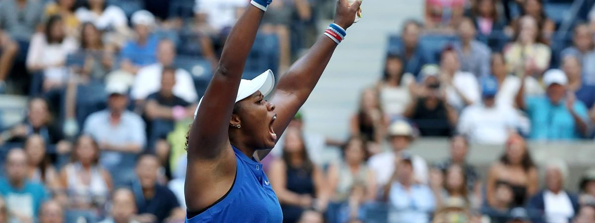Taylor Townsend, of the United States, reacts after defeating Simona Halep, of Romania, during the second round of the US Open tennis championships Thursday, Aug. 29, 2019, in New York. (AP Photo/Kevin Hagen)