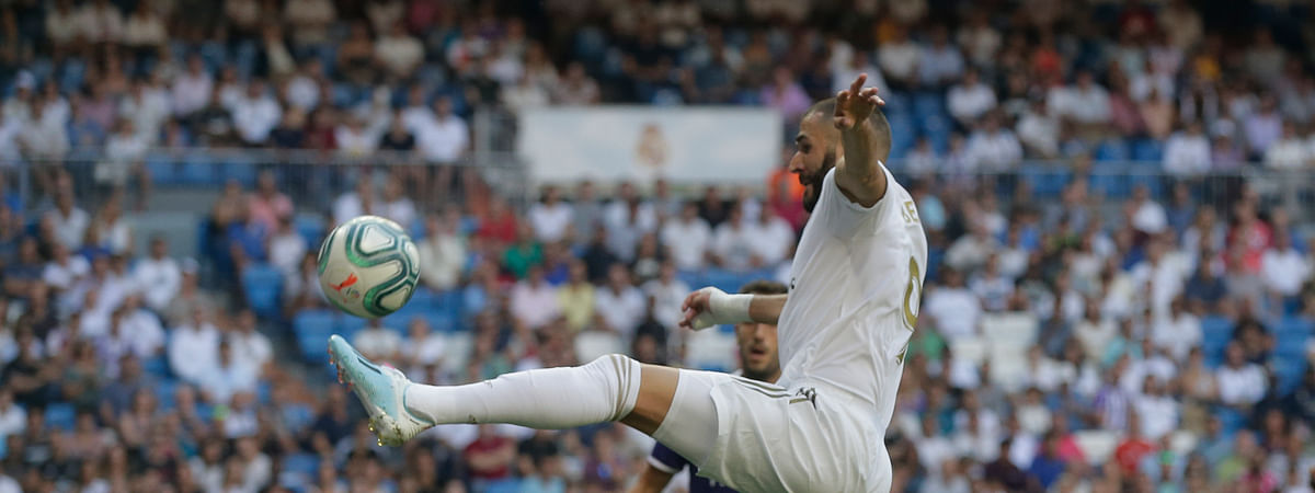 Real Madrid's Karim Benzema controls the ball during the Spanish La Liga soccer match between Real Madrid and Valladolid at the Santiago Bernabeu stadium in Madrid, Spain, Saturday, Aug. 24, 2019.