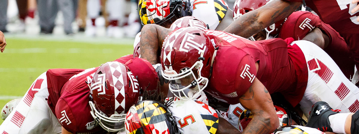 Maryland running back Anthony McFarland Jr. (5) is stopped short of the goal line by Temple defensive end Zack Mesday, left, and linebacker Shaun Bradley, right, during the second half of an NCAA college football, Saturday, Sept. 14, 2019, in Philadelphia. Temple won 20-17. (AP Photo/Chris Szagola)