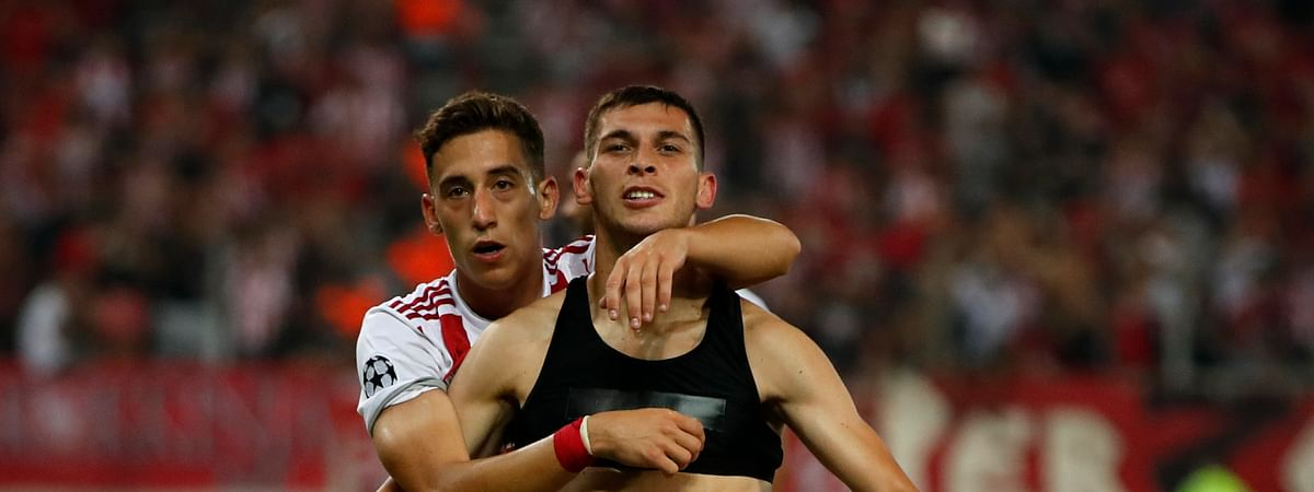 Olympiakos' Lazar Randelovic, right, celebrates after scoring his side's third goal during the Champions League qualifying playoff first leg soccer match between Olympiakos and Krasnodar at Georgios Karaiskakis stadium in Piraeus port, near Athens, Wednesday, Aug. 21, 2019. Olympiakos won 4-0. (AP Photo/Thanassis Stavrakis)
