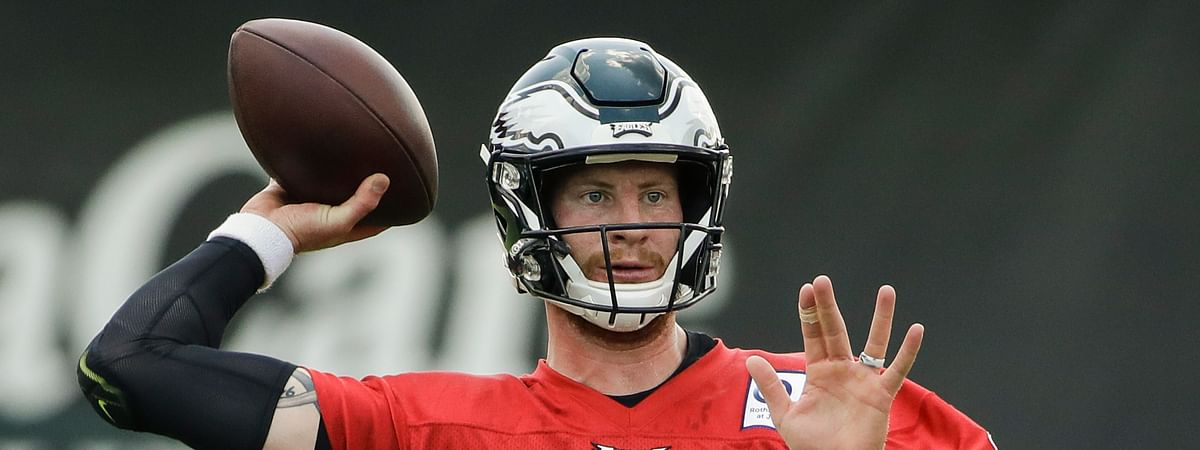 FILE - In this July 25, 2019, file photo, Philadelphia Eagles quarterback Carson Wentz throws a pass during practice at the NFL football team's training camp in Philadelphia. Wentz, Jason Peters and Darren Sproles have unfinished business. The franchise quarterback, the nine-time Pro Bowl left tackle and the versatile veteran were injured when the Eagles won the first Super Bowl in franchise history following the 2017 season. They are determined to deliver another parade down Broad Street. (AP Photo/Matt Rourke, File)