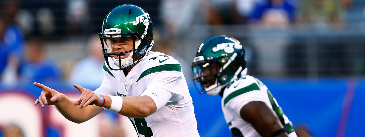 In this Aug. 9, 2019, file photo, New York Jets quarterback Sam Darnold calls out to teammates as running back Ty Montgomery stands nearby during the first half of the team's preseason NFL football game against the New York Giants in East Rutherford, N.J.